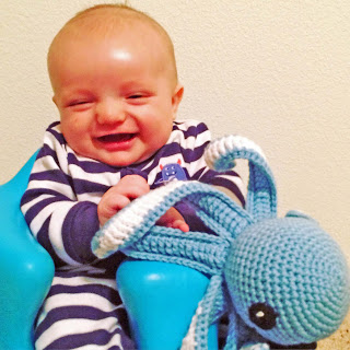 baby playing with crocheted octopus